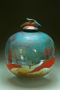 Blue Dolphin urn that holds cremated remains for two, by artist Steven Forbes-deSoule, available for $770 at ShineonBrightly.com